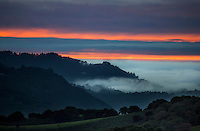 The sun sets beyond the approaching marine layer at Carmel Valley, California