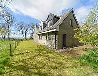 """BNPS.co.uk (01202) 558833. <br /> Pic: KnightFrank/BNPS<br /> <br /> Pictured: The property comes with this three-bedroom cottage that was the original Victorian laundry for the castle, which is now used as a holiday let.<br /> <br /> A castle that was burnt down by a pirate, involved in the English Civil War and has been in the same family for five centuries is on the market for offers over £650,000.<br /> <br /> Kilberry Castle, which dates back to the 15th century, has an incredible history and still has a wealth of original features including a 288-year-old mausoleum.<br /> <br /> It sits in 21 acres of land on the Scottish west coast, with stunning views over Kilberry Bay and out to the islands of Islay, Jura and Gigha.<br /> <br /> The four-storey tower house now needs a buyer """"with deep pockets and great imagination"""" to carry out a complete refurbishment but it has a lot of potential."""