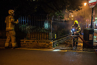 The Fire & Rescue Service attend to a burning temporary structure in a park in Highbury. London. 17-6-19