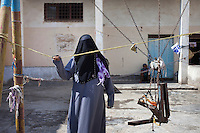Tofaha in the courtyard of the Central Prison in Hodeidah where 58 women and 7 children are held. Tofaha, who is there with ehr children is waiting on charges of adultery, for which she claims innocence. One inmate said: 'In Yemen, being a woman is like being an animal.' Another said says: 'Let's not talk about human rights. Let's talk about animal rights because that's what we are.'