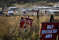 The now abandoned Camp X-ray at the American naval base at Guantanamo Bay, where over 600 alleged al Qaeda members have been held indefinitely. Described by the US as 'unlawful enemy combatants', they were captured primarily in Afghanistan during the 'war against terror'.
