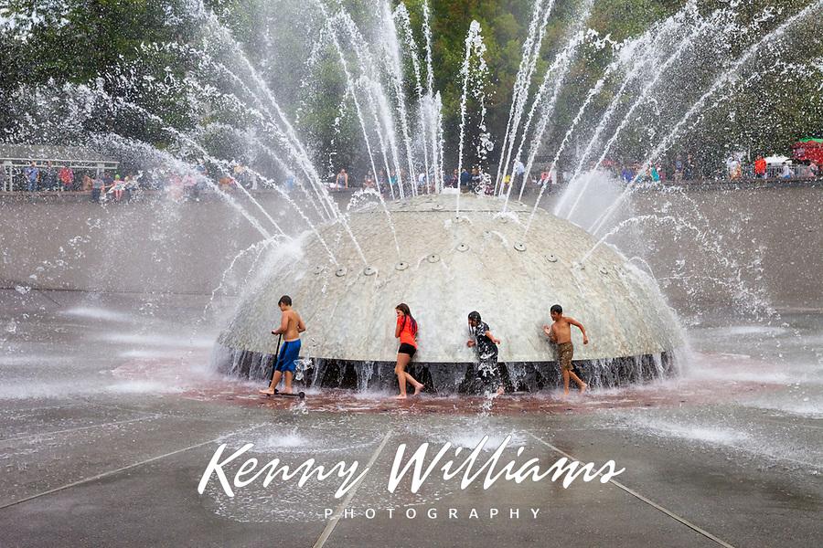 Children Playing Around Water Fountain, Seattle Center, WA, USA.
