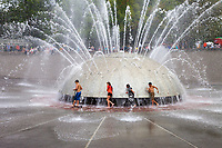 Children Playing Around Water Fountain, Seattle Center, WA, USA.