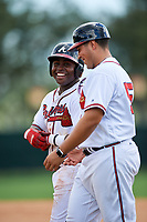GCL Braves right fielder Trey Harris (5) with coach Wigberto Nevarez (55) during the first game of a doubleheader against the GCL Yankees West on July 30, 2018 at Champion Stadium in Kissimmee, Florida.  GCL Yankees West defeated GCL Braves 7-5.  (Mike Janes/Four Seam Images)