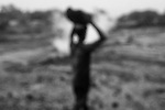 A boy carries scavanged coal to his house at Laltenganj, Jharia, Jharkhand, India
