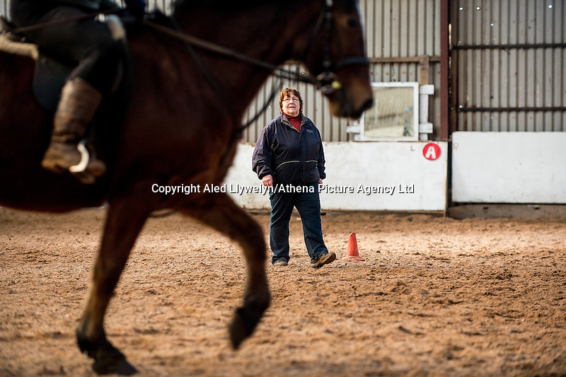 FAO Laura Lean.<br /> Friday 20 January 2017<br /> Pictured: Sue Scourfield looks on as horses exercise in the barn <br /> Re: Sue Scourfield's riding school is  being hit by increasing business rates.