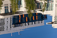 A San Francisco building is reflected in MIssion Creek's rippled waters.