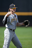 Kal Simmons (10) of the Kennesaw State Owls warms up in the outfield prior to the game against the prior to the game against the Winthrop Eagles at the Winthrop Ballpark on March 15, 2015 in Rock Hill, South Carolina.  The Eagles defeated the Owls 11-4.  (Brian Westerholt/Four Seam Images)