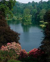 Looking down on the great lake at Stourhead surrounded by magnificent trees and rhododendrons in full bloom
