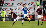 Perry Kitchen tackles Andy Halliday as Don Cowie watches on
