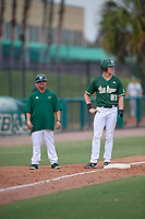 USF Bulls coach Chris Cates (left) and Garrett Zech (27) during a game against the Dartmouth Big Green on March 17, 2019 at USF Baseball Stadium in Tampa, Florida.  USF defeated Dartmouth 4-1.  (Mike Janes/Four Seam Images)