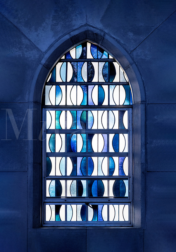 Blue abstract stained glass window.