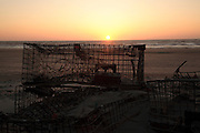 Sunrise at Hampton Beach, New Hampshire with a lobster trap in the foreground.
