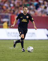 Andres Iniesta (8) of Barcelona brings the ball up the field during the friendly at FedEX Field in Landover, MD.  Manchester United defeated FC Barcelona, 2-1.