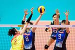 Ting Zhu of China (L) attacks the block of Mami Uchiseto (C) and Haruyo Shimamura of Japan (R) during the match between China and Japan on May 30, 2018 in Hong Kong, Hong Kong. (Photo by Power Sport Images/Getty Images)