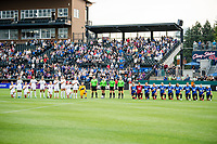 TACOMA, WA - JULY 31: OL Reign and Racing Louisville FC during the national anthem before a game between Racing Louisville FC and OL Reign at Cheney Stadium on July 31, 2021 in Tacoma, Washington.