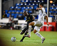LAKE BUENA VISTA, FL - JULY 18: Bradley Wright-Phillips #66 of LAFC shoots and scores while pressured by Giancarlo González #21 of LA Galaxy during a game between Los Angeles Galaxy and Los Angeles FC at ESPN Wide World of Sports on July 18, 2020 in Lake Buena Vista, Florida.