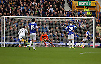 Pictured: Leighton Baines of Everton (R) is scoring the opening goal from the penalty spot against Michel Vorm of Swansea (C). Saturday 22 March 2014<br /> Re: Barclay's Premier League, Everton v Swansea City FC at Goodison Park, Liverpool, UK.