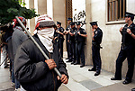 Economic Turmoil in Argentina<br /> A stand off between pickets wearing masks and carrying metal staves and the police. 2000s 2002