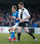 Kevin Kyle nudges Dean Shiels off the ball and gets a yellow card