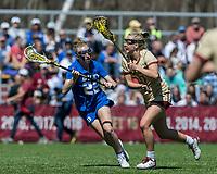 Newton, Massachusetts - April 6, 2019: NCAA Division I. Maintaining an undefeated season, Boston College (white) defeated Duke University (blue), 20-12, at Newton Campus Lacrosse Field.