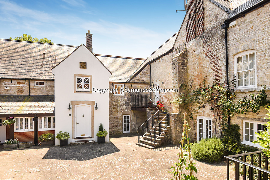 BNPS.co.uk (01202 558833)<br /> Pic: Symonds&Sampson/BNPS<br /> <br /> Hardy history... Stinsford House in Dorset. <br /> <br /> A charming home which features in a Thomas Hardy novel has emerged on the market for £500,000.<br /> <br /> Grade II listed Stinsford House, in the idyllic village of Stinsford, Dorset, is referenced in the writer's 1872 novel 'Under The Greenwood Tree'.<br /> <br /> It is believed that the tree in the courtyard is the one Hardy wrote about in the romantic tale.<br /> <br /> Hardy was very attached to the village which is on the outskirts of the market town of Dorchester. He was baptised at St Michael's Church in the village and his church group is thought to have performed at the 17th century property every Christmas Eve. Following his death in 1928, his second wife fulfilled Hardy's request for his heart to be buried at St Michael's Church, while his ashes were interred at 'Poets Corner' in Westminster Abbey.<br /> <br /> The property is being sold with estate agent Symonds & Sampson.