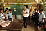 Second grade school teacher conducts class in Midway Village in Southern Belize.<br /> A traditional Mayan village.