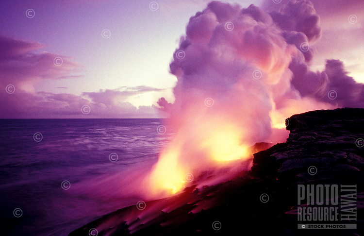 Large steam plume created from lava flow reaching the sea, Hawaii Volcanoes National Park