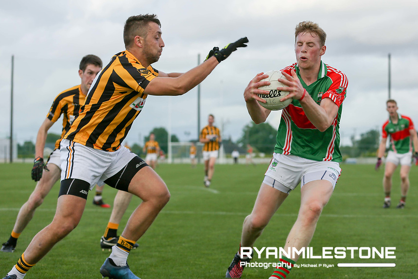 2017 Mid Tipperary Senior Football Final,<br /> Loughmore/Castleiney vs Upperchurch/Drombane,<br /> Saturday 9th September 2017,<br /> Littelton, Co Tipperary,<br /> Brian McGrath in action against James Barry of Upperchurch/Drombane.<br /> Photo By: Michael P Ryan