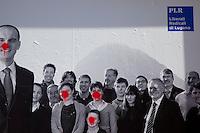 Switzerland. Canton Ticino. Lugano. Election day. Election poster of the PLR political party ( Liberali Radicali di Lugano). Graffiti. 14.04.13. © 2013 Didier Ruef