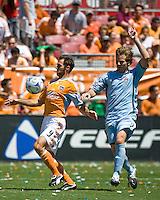 Houston Dynamo midfielder Brian Mullan (9) shields the ball from Colorado Rapids defender Jordan Harvey (2).  Houston Dynamo defeated Colorado Rapids 1-0 at Robertson Stadium in Houston, TX on April 19, 2009.