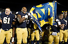 Nov. 3, 2012; Players celebrate in front of the student's section after defeating Pittsburgh 29 to 26 in triple overtime. Photo by Barbara Johnston/University of Notre Dame