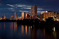 Dusk settles on the Austin Skyline as the clouds roll into formation while a beautiful reflection bounces off of Town Lake Austin.