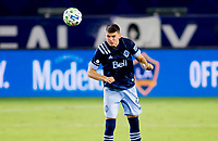 CARSON, CA - OCTOBER 18: Ranko Veselinovic #4 of the Vancouver Whitecaps heads a ball during a game between Vancouver Whitecaps and Los Angeles Galaxy at Dignity Heath Sports Park on October 18, 2020 in Carson, California.