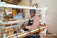 Africa, Swaziland, Malkerns.Nest organization artisan project, partnering with Rosecraft weaving  & local artisans to help market their products to global markets and better sustain their local community. Women weaving at the looms.