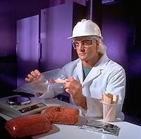Man inspecting ground beef.
