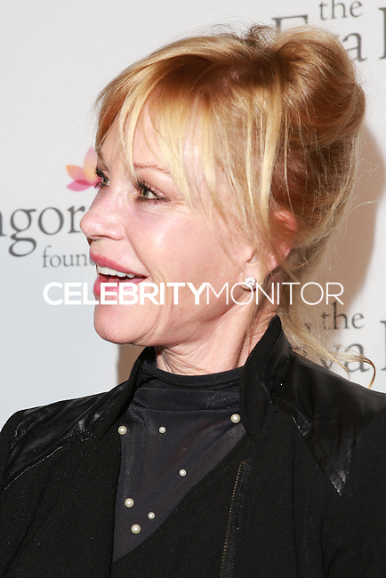 HOLLYWOOD, LOS ANGELES, CA, USA - OCTOBER 09: Melanie Griffith arrives at the Eva Longoria Foundation Dinner held at Beso Restaurant on October 9, 2014 in Hollywood, Los Angeles, California, United States. (Photo by David Acosta/Celebrity Monitor)
