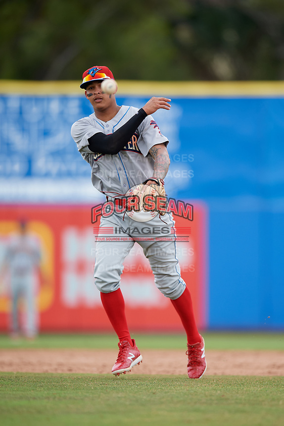 Clearwater Threshers shortstop Arquimedes Gamboa (7) throws to first base during a game against the Dunedin Blue Jays on April 8, 2018 at Dunedin Stadium in Dunedin, Florida.  Dunedin defeated Clearwater 4-3.  (Mike Janes/Four Seam Images)