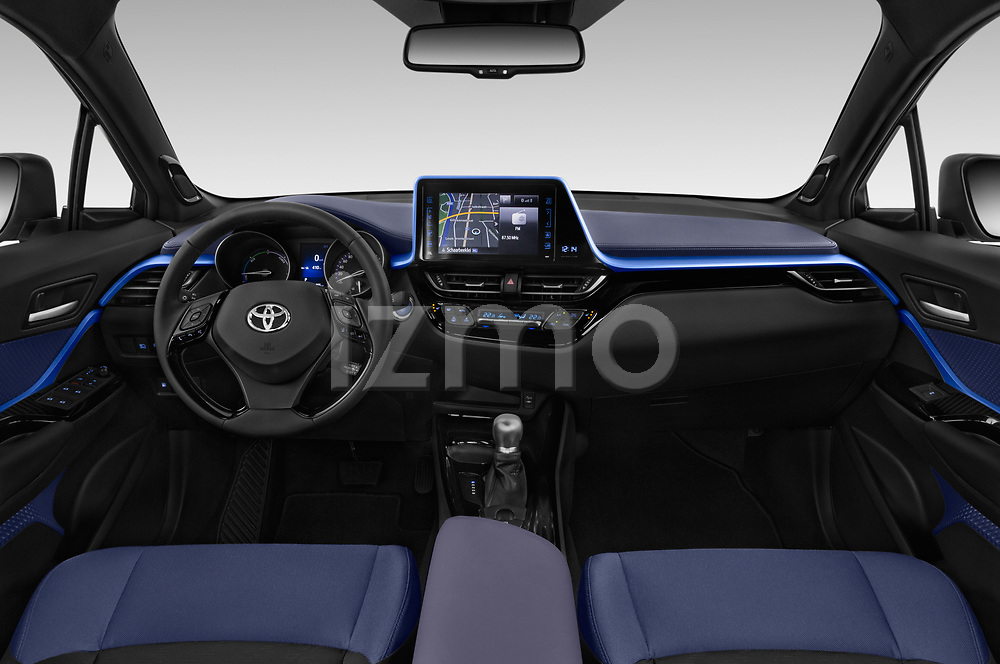 Stock photo of straight dashboard view of a 2018 Toyota C-HR C-LUB hybrid 5 Door SUV