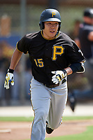 Pittsburgh Pirates third baseman Jung Ho Kang (15) runs to first base during a Florida Instructional League game against the Toronto Blue Jays on September 20, 2018 at the Englebert Complex in Dunedin, Florida.  Kang is on rehab assignment after having surgery on his left wrist to remove cartilage.  (Mike Janes/Four Seam Images)