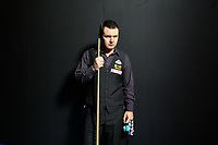 CHINA. Beijing. English snooker player Stephen Maguire, who is ranked number 2 in the world in 2009, backstage just before going to play at the China Snooker Open. Snooker is a cue sport played on a large table measuring 3.6 metres x 1.8 metres. Originating in India in the late 19th Century where it was invented by British Army officers, the game has been a mainstay in British sport over the past few decades. Recently however, popularity of the sport has declined as the sport struggles to compete with other popular sports. The sport is however flourishing in countries such as China, where it is now the second most popular sport, behind Basketball. In a country where the  players are treated like movie-stars, China may be the great hope for the sports recovery. 2009