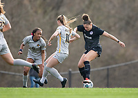 LOUISVILLE, KY - MARCH 13: Jorian Baucom #33 of Racing Louisville FC and Jordan Brewster #10 of West Virginia University fight for the ball during a game between West Virginia University and Racing Louisville FC at Thurman Hutchins Park on March 13, 2021 in Louisville, Kentucky.