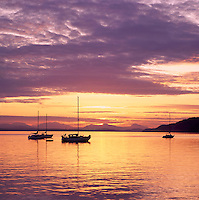 Sailboats anchored at Sunset in Montague Harbour Provincial Marine Park, Galiano Island, Southern Gulf Islands, BC, British Columbia, Canada
