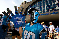 09/16/07 :  A fully decorated fan shows enthusiasm before the start of a Carolina Panthers' game. ...The Carolina Panthers, professional American NFL football team that represents both North Carolina and South Carolina, is based in Charlotte, North Carolina. The Panthers began playing in 1995 as part of the National Football League?s expansion program. They are members of the National Football Conference (NFC) South Division. They play in the Bank of America Stadium, located in downtown Charlotte.