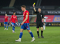 20th April 2021; Liberty Stadium, Swansea, Glamorgan, Wales; English Football League Championship Football, Swansea City versus Queens Park Rangers; Rob Dickie of Queens Park Rangers receives a Yellow card from Referee Jarred Gillett