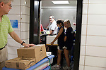 August 20, 2011. Chapel Hill, NC.. American Eagle volunteers Pinelopi Kyriazi and Astin Barnes, in elevator, are a few of many American Eagle student volunteers who fanned out around the UNC campus on move in day to raise awareness of the brand by giving out coupons and helping incoming students move in to the dorms.. Many companies have increased their efforts to reach the youth market by employing popular college students to raise the awareness of the brand by peer to peer marketing on campus' around the country.