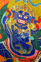 Vajrapani, or Chana Dorje in Tibetan, in wrathful form is blue protector bodhisattva, guardian of Tantric faith, wears a tiger skin and snake around neck, on  rock painting at Sera Monastery, Lhasa, Tibet, China.