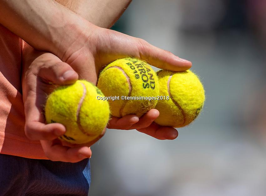 Paris, France, 27 May, 2018, Tennis, French Open, Roland Garros, ballboy holding Roland Garros tennis balls<br /> Photo: Henk Koster/tennisimages.com