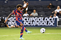 KANSAS CITY, KS - JULY 15: Gianluca Busio #6 of the United States shoots on goal during a game between Martinique and USMNT at Children's Mercy Park on July 15, 2021 in Kansas City, Kansas.
