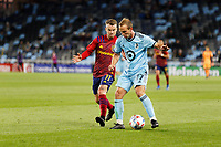 SAINT PAUL, MN - APRIL 24: Chase Gasper #77 of Minnesota United FC and Albert Rusnak #11 of Real Salt Lake battle for the ball during a game between Real Salt Lake and Minnesota United FC at Allianz Field on April 24, 2021 in Saint Paul, Minnesota.